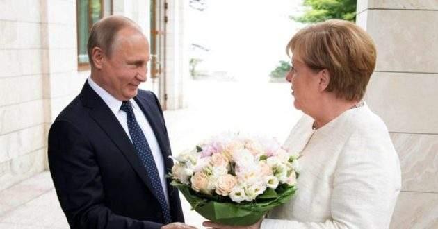 Зачем Путин подарил Меркель белые розы: СМИ заметили оскорбительный намек